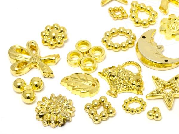 aufnahteile-und-motive-aus-acrylglas-von-star-bright-7-0-20-0mm-gold-motiv-mix-100-stuck