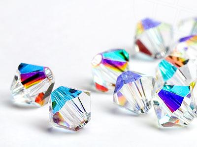 glasperlen-zum-auffadeln-von-swarovski-elements-doppelkegel-10mm-crystal-ab-12-stuck