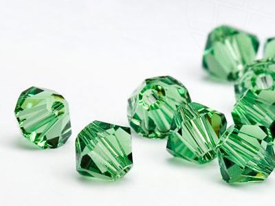 glasperlen-zum-auffadeln-von-swarovski-elements-doppelkegel-5mm-erinite-72-stuck
