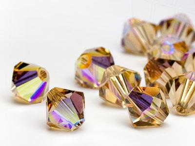 glasperlen-zum-auffadeln-von-swarovski-elements-doppelkegel-5mm-light-colorado-topaz-ab-720-stuc