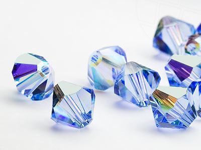 glasperlen-zum-auffadeln-von-swarovski-elements-doppelkegel-5mm-light-sapphire-ab-720-stuck-5-g