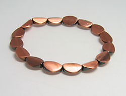 Fashion jewelry bracelet with threaded beads, copper